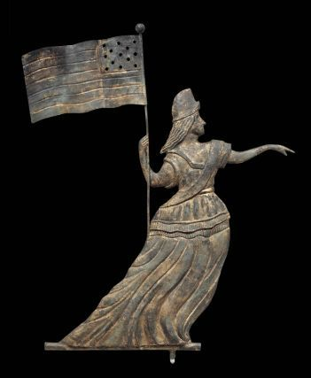 A copper weathervane, 1860-80, from Pennsylvania depicting the goddess of Liberty weather vane; she wears a Phrygian cap and holds the American flag. (Museum of Fine Arts, Boston)