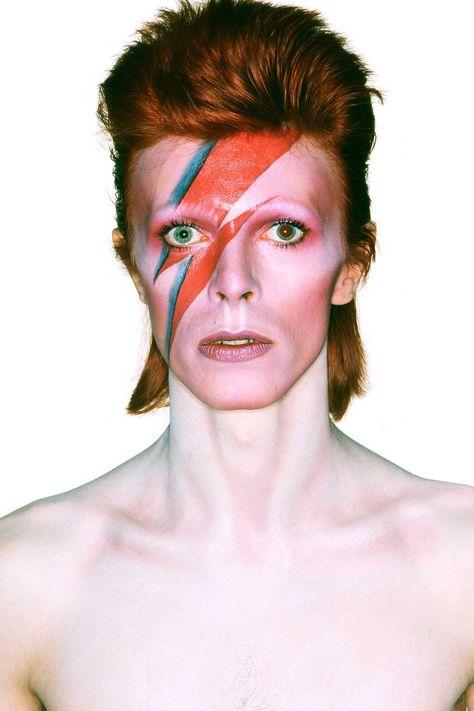 """1973 Album cover shoot for Aladdin Sane, photographed by Brian Duffy. The lightning bolt represented the duality of the mind, although Bowie later explained that the """"lad insane"""" of the album's title track was inspired by his brother Terry, who was diagnosed as a schizophrenic. Photo By Brian Duffy"""