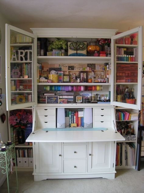 Ikea Hemnes secretary desk with hutch and two hemnes bookshelves for the sides. For a built-in look carefully remove molding and place it in the front. Love this idea for craft storage!