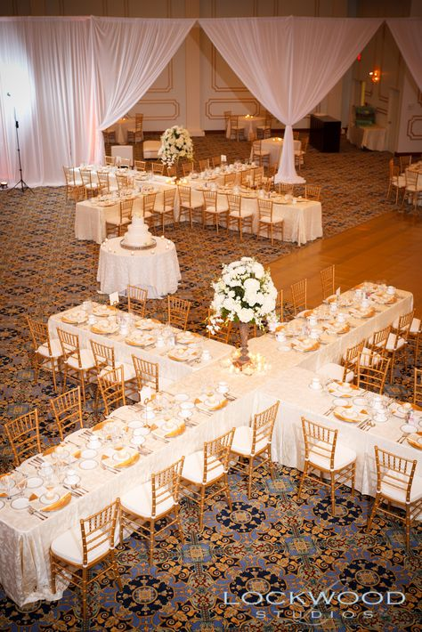 One way to cut back on centerpieces. - people often overlook designing table set ups in non-traditional fashions and focusing on tablescapes rather than centerpieces to cut costs. Tablescaping can be breath-taking when done right and are very customizable.