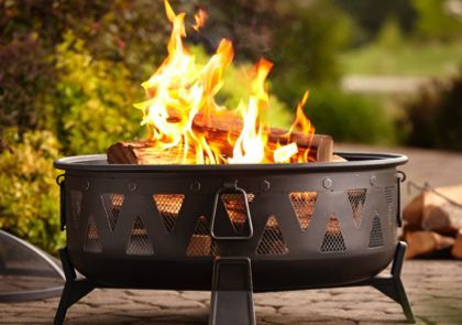 A Wood Burning Fire Pit On A Patio With Images Fire Pit Patio Propane Patio Fire Pit Fire Pit
