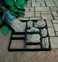 Make your own concrete walkway with these molds....also like this mold w/ the stone like effect spray  paint