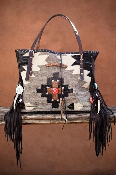 THE ORY TOTE: Navajo Handbags made from blankets / rugs, vintage horse tack, and deer, elk or cowhide leathers. I embellish the bags with vintage trade beads, turquoise, coral, nickel silver/German silver Concho buttons, nickel silver spots/studs, and deer antler tips.