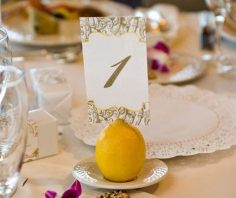 Lemons for table number stands.