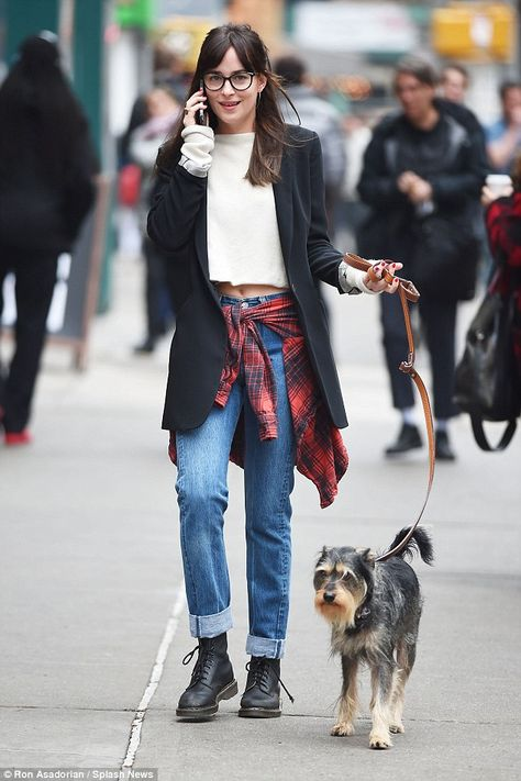 Leisurely stroll: The Fifty Shades Of Grey actress sported a geek chic look for the stroll...