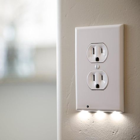 Walking around at night with the lights out can be dangerous! Stepping on something hard or sharp or bumping into walls and furniture is painful. Ouch! Never suffer with bruised shins or toes again, with the Lux Light Sensor Outlet. This clever outlet installs in seconds and requires no hard-wiring at all. Simply push it into its proper place and a set of contacts will touch the necessary cables to complete the circuit. This outlet is designed to look just like any standard outlet cover by day,  Dark Hallway, Up House, House App, Wall Outlets, Kitchen Outlets, Led Night Light, Night Lights, Nite Light, Light Sensor