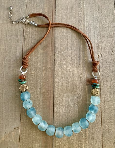 """Fair trade recycled glass and filigree brass, turquoise, red agate, vegan leather, approx. 20"""" with 1"""" extender chain. Given the uniqueness of natural gemstones and handmade beads, and availability, some variation may occur and will be as close as possible to what is pictured."""