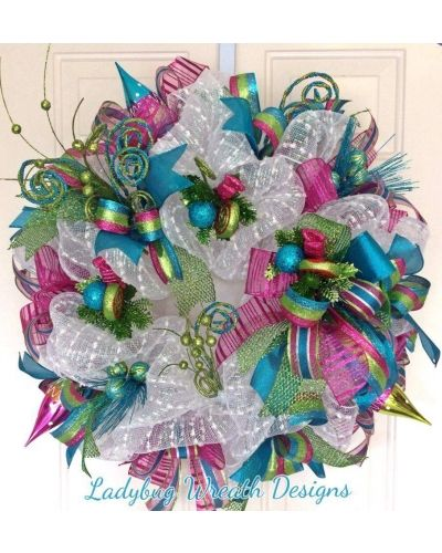Turquoise, Hot Pink and Lime Green pop on this Christmas Fun wreath submitted by Ladybug Wreath Designs to CraftOutlet.com Photo Contest