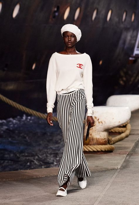 de5303f0 A look from Chanel's Cruise 2019 collection. #Chanel #Cruise2019  #whiteberet #beret #stripedpants