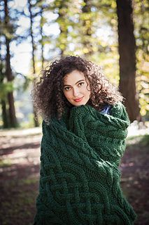 Beanstalk Throw blanket knitting pattern by Kath Andrews.  Knit with super bulky weight yarn.  Lots of cables!