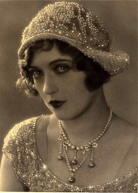 Beautiful Flapper - in a sparkly beaded cloche and matching dress (note the pearl and diamond bow necklace -wow)