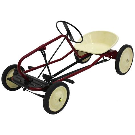 For Sale on 1stdibs - The pedal car is made of tube steel base partially black and red brown and ivory lacquered. The wheels and the pedals are made of rubber. The seat shell