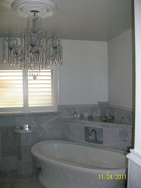 My mother in law's re-modeled bathroom.  All marble with a cascading chandelier.