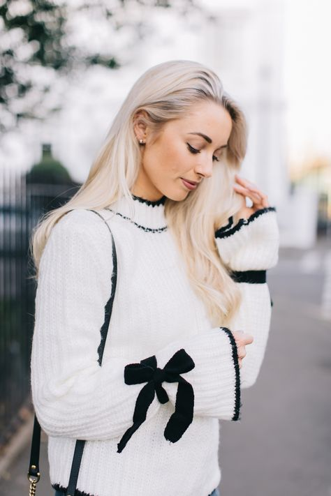 Shop this Outfit The Knitwear Styles that are all over your feed. When it comes to statement knitwear pieces, I feel like I pretty much hit the jackpot with this beauty. Monochromatic, bow details and…