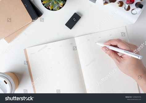 Top View Of Hand Writing On Open Calendar Planner For Business