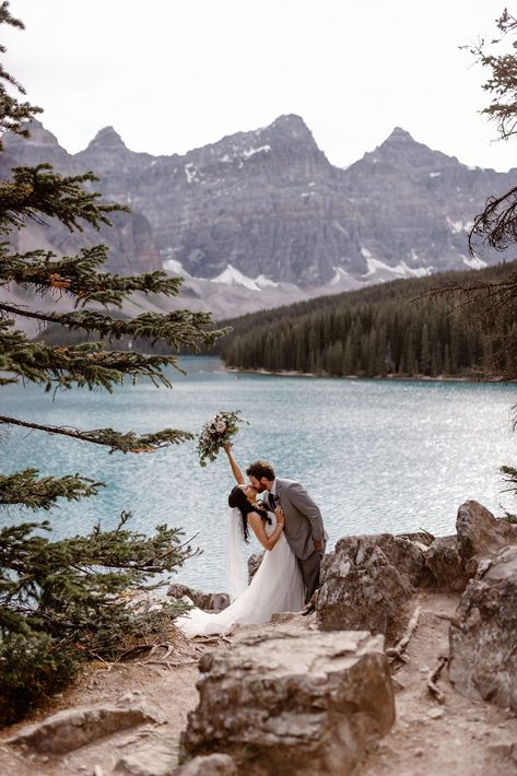 This Couple Ended up Loving Their Downsized Wedding at Fairmont Lake Louise - moraine lake, bride and groom Covid Wedding Inspiration and Advice - on the Brontë Bride Blog #covidwedding #weddingplanningadvice #covidweddingadvice #diywedding #weddingadvice #weddingplanningtips #albertawedding #canadianweddinginspiration #weddingsalberta #weddingscanada