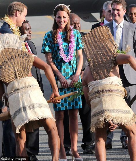 Catherine, Duchess of Cambridge, watches traditional dancing at Honiara International Airport.