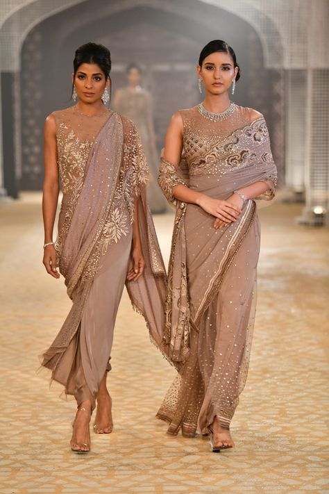 Tarun Tahiliani ICW 2018 collection has phenomenal red bridal lehengas along with fusion wear sarees. Also see under lakh Tarun Tahiliani Lehengas.