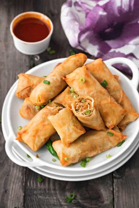 These rolls, as can be seen, are crisp from outside and have spicy veg stuffing within. At home, we can make these either using homemade spring rolls wrappers or from store bought spring roll sheets too. Serve these crisp Chinese spring rolls with hot dipping sauce as a snacks for tea time or starters at weekend dinners or parties. #vegetarianrecipes #eggrolls