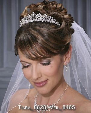 Inspiration for your wedding - the veil tiara combo. Learn tips for wearing a tiara and attaching a veil by clicking the picture!