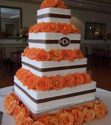 Orange wedding cake no gold purple plz ribbon and flowers | Orange ...