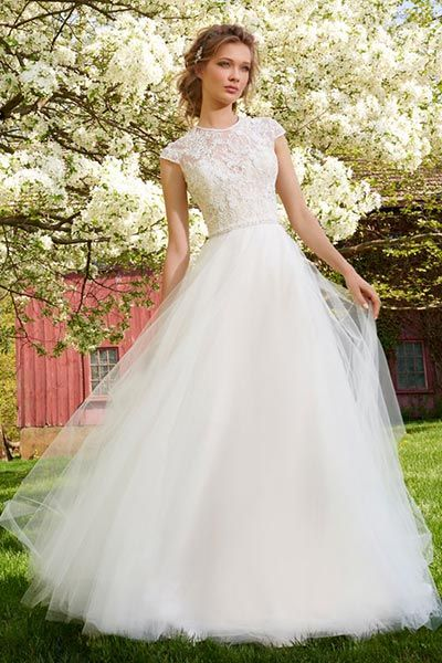 A-line Tulle wedding gown. Embroidered floral appliques embellished ...