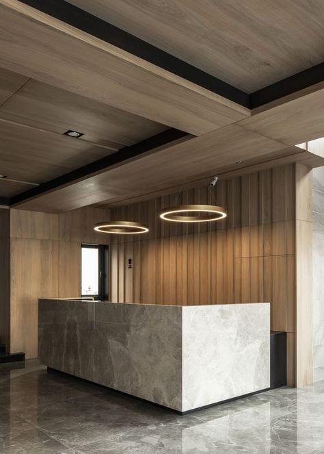 Circular led pendant above reception desk