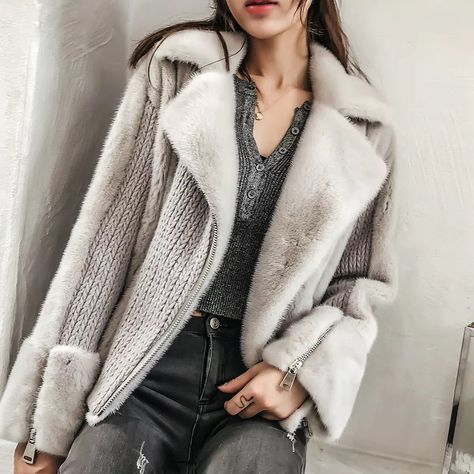 A grey sweater with faux collar and sleeves. Faux fur A grey sweater with faux collar and sleeves.