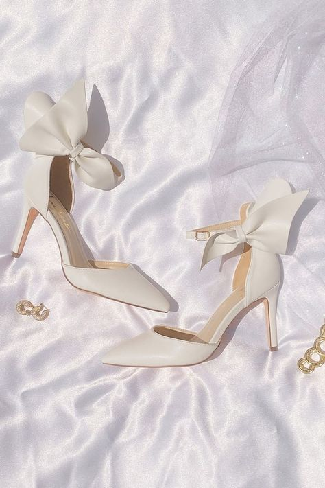 These heels were made for walking down the aisle. Lulus Lizaa White Bow Ankle Strap Pumps and gold jewelry put the finishing touch on your bridal look. #lovelulus