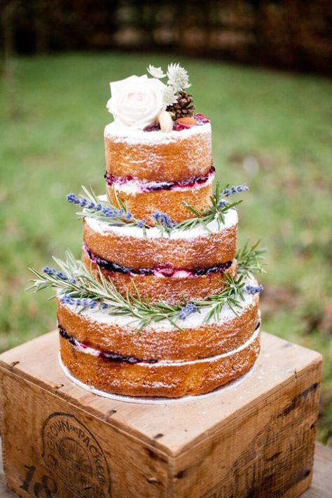 A naked cake - basically no frosting or icing - is a trend right now a la the rustic trend and trend toward DIY weddings. Cake by French Made.