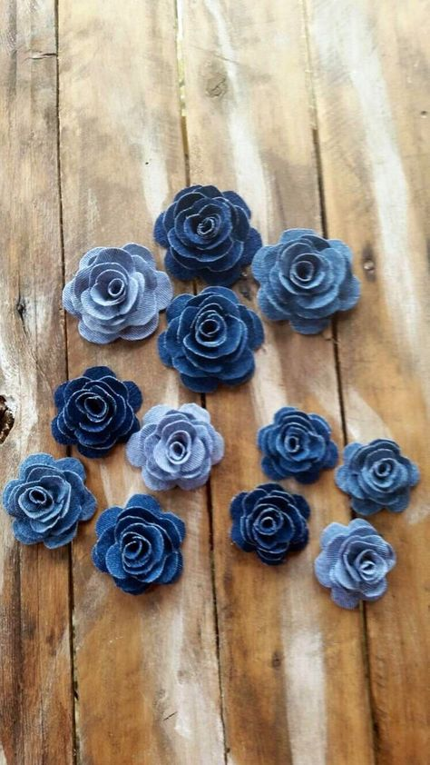 This listing is for 6 upcycled denim flowers. Choose from 2 and 1/2 inches, 3 inches, 4 inches or 2, 2 1/2, 2, 3 and 2, 4 inch flowers. The flowers will come in a variety of shades of denim. Each petal has been hand cut and reassemble. The fabric has been treated for fraying and stiffened. They are