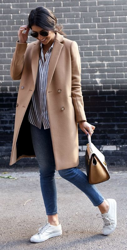 camel jacket, striped blouse, denim, and white sneakers