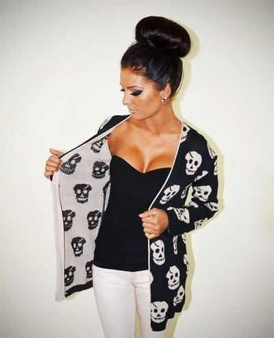 skull sweater. And someday my bun will be this big haha