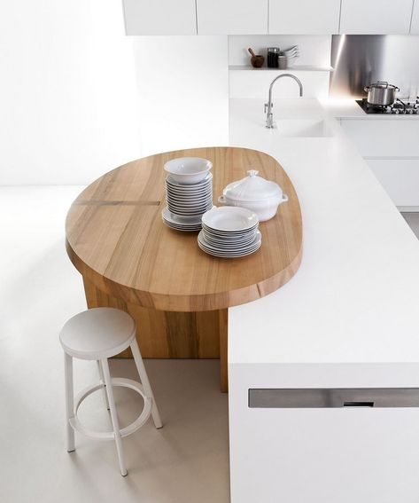 ♥Love this: break out of the standard island shape to creat a designated space, soften all the hard edges and sharp corners with curves and warmer natural material.