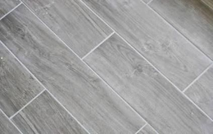 Pin By Cassie Dunnam On New Home Finishes In 2020 Grey Wood Tile Gray Wood Tile Flooring Wood Plank Tile