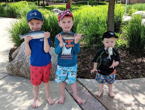 Mom's photo of 3 sons posing with fish on family outing sets the internet ablaze