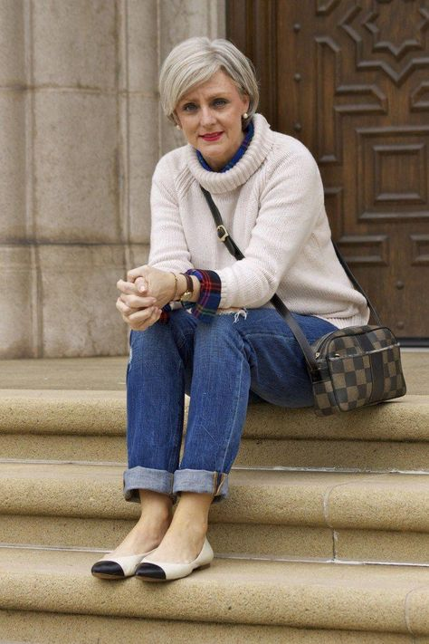 A simple outfit is sometimes the best outfit! This look features a chunky turtleneck paired with a plaid flannel shirt underneath for style and blue jeans . These distressed jeans by Levi Strauss are a wardrobe staple! #fashionblogger #casualstyle #casualoutfits #fashionover50 #womensfashionover40over50cardigans