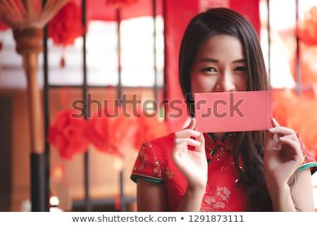 40390d865 Happy Asian Chinese Woman in Cheongsam Traditional Red Dress Showing Red  Envelope (Ang Pao) in Chinese New Year