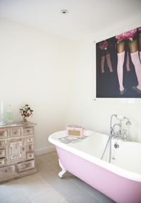 I want a pink bathtub!! I babysat for a couple who had a pink bathtub and I want this one!