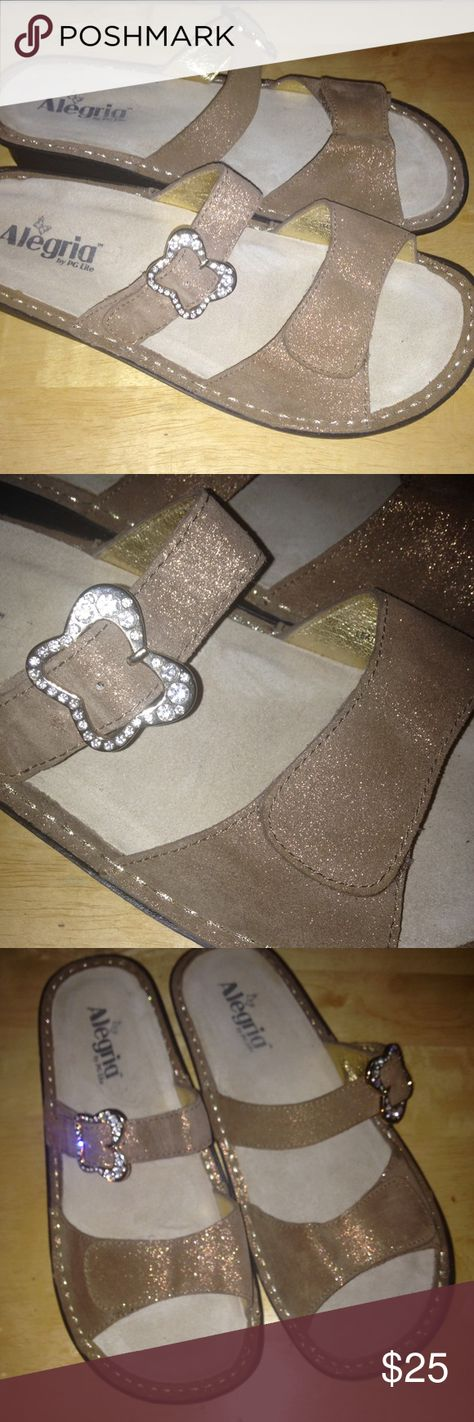 Super cute Alegria sandals Super comfortable sandals by Alegria. Velcro closure across toes. Beautiful buckle adjusts fit through instep.  Textured napa leather is tan with gold fleck. The insoles are replaceable. Alegria Shoes Sandals