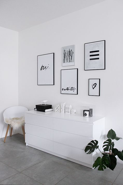 Wall gallery with the Ma Maison Blanche, Ylva Skarp and Helmut Newton posters and Normann Copenhagen and Kähler decor on the white cabinet and Hay About Chair