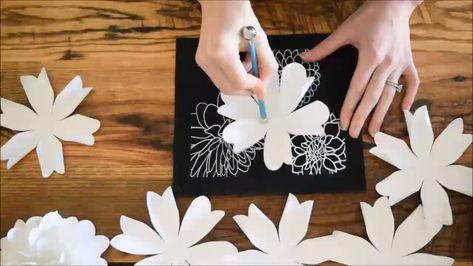 How to make paper flower kissing balls. Create your very own 3D paper flower pomander balls for hanging as wedding decor. Create flower garland or hang them along the wedding aisle for a classic decoration. Instant download printable templates and SVG cut files for Cricut included along with full tutorial.