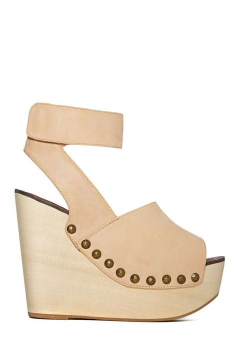 We know you've been on the hunt for the perfect nude wedge, so we picked up these beauties from Jeffrey Campbell with you in mind! They feature a tan leather upper with a peep toe, velcro closure at ankle strap, and bronze studded detailing.