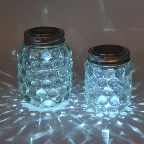mason jar luminaries - add solar light, leave on picnic table during the day to charge, always have a light when you return to camp