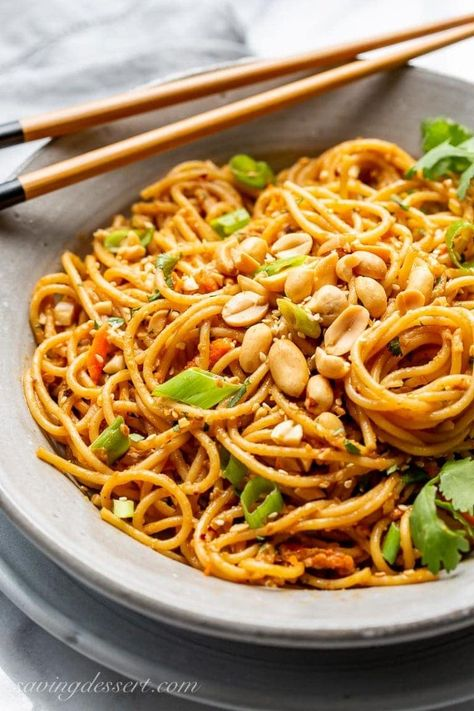 Try our Spicy Peanut Noodles for a quick and easy meatless main or tasty side dish. Great served cold, warm or room temperature and leftovers are the best! #spicypeanutnoodles #thainoodles #noodles #peanutnoodles #peanutsauce #asianpeanutnoodles #spicynoodles #meatlessmain #easysidedish #asiannoodles