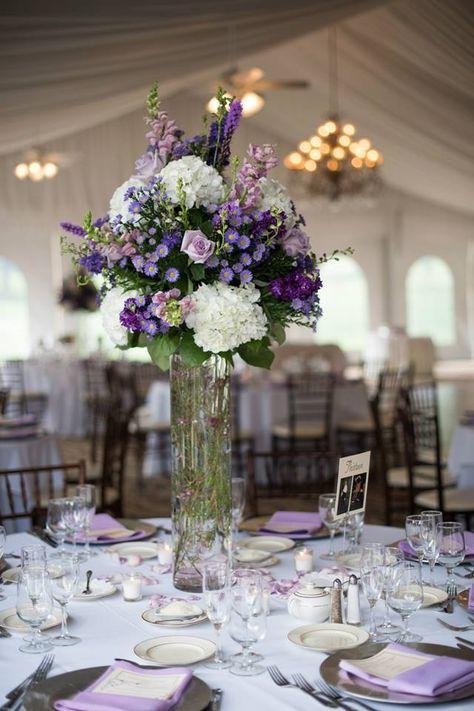Purple center pieces in the Grand Outdoor Ballroom #westhillscountryclub #hudsonvalleyweddings
