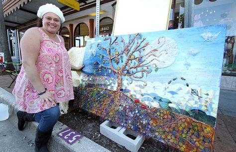 Sarasota artist Midgeann Schotsch stands next to one of her works, which was made totally from recycled materials. Schotsch also crafts jewelry in historic downtown Sarasota, an area she considers one of the best places in the country to live as an artist.