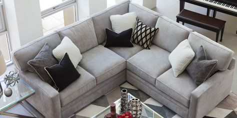 The gray Axis 2 Piece Sectional works well with many other colors. Sit or lay many ways comfortably, as the polyester fabric is soft to the touch. Shop online now. #LivingSpaces