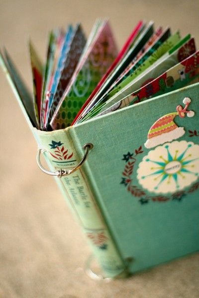Use old Christmas book cover and fill with all our family Christmas cards through the years.