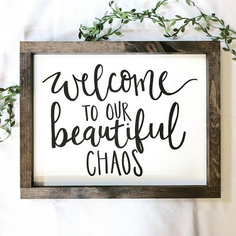 This hand lettered sign measures 18x14. They are lettered with white and black acrylic paint, without the use of vinyl or stencils for a truly one-of-a-kind look. The back is MDF board and the frame is pine wood. This helps keep the signs fairly lightweight for easier hanging. Comes with a